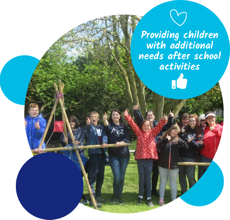 """Group of children and volunteers with thumbs up. Caption reads """"Providing children with additional needs after school activities""""."""